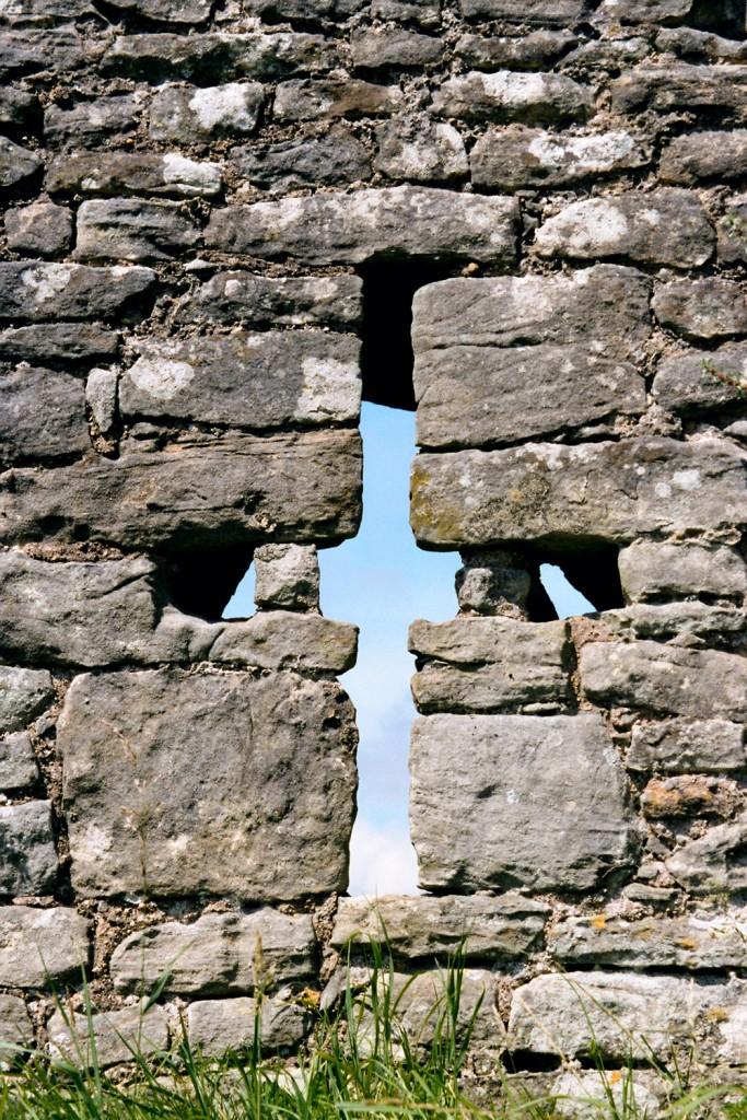 stone cross in wall